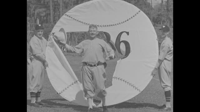 Spring at Last superimposed on Washington Senators players throwing and catching at spring training / large paper baseball 1936 that players break...