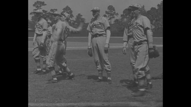 """st louis cards get set for 1937 season"" / title: ""daytona beach, fla"" superimposed over team running onto field / st. louis cardinals manager... - hand of cards stock videos & royalty-free footage"