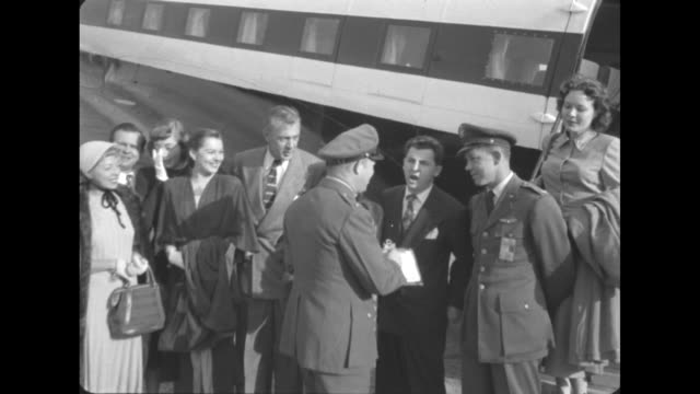 starlift stars at travis air base premiere / group of hollywood stars standing next to airplane at travis air force base includes gary cooper lucille... - war veteran stock videos & royalty-free footage