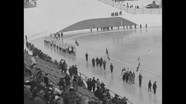 stars of 17 nations race in olympics governor roosevelt of new york greets athletes after parade with opens big international meet at lake placid /... - 1932 winter olympics lake placid stock videos and b-roll footage