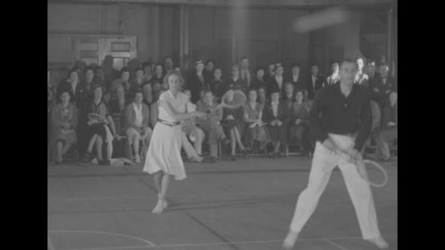 stars test new game of tennis superimposed over bill tilden and alice marble playing battleboard tennis / vs of tilden and marble lob ball back and... - 発明家点の映像素材/bロール