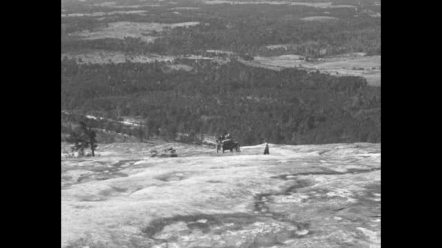 stone mountain ga 'depression' coughs its last and pitches off cliff / car named depression on top of stone mountain inscribed come kill depression... - フォード・t型モデル点の映像素材/bロール