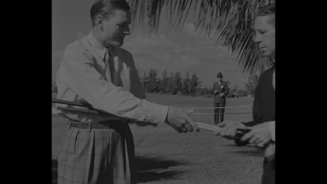 SubPar Golf / title Coral Gables Fla Superimposed over spectators on golf course / MS Harold McSpaden selects 14 clubs and sticks them in golf bag /...