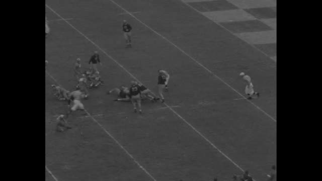 sugar bowl superimposed over filled stadium / vs football game with stadium crowd cutaways - university of tennessee stock videos and b-roll footage