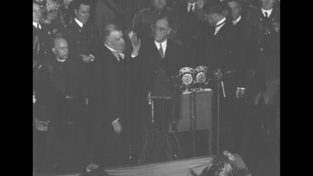 vídeos de stock e filmes b-roll de swear roosevelt as ny governor albany state chief takes oath of office with jeffersonian simplicity as he starts second term / standing at podium... - 1931
