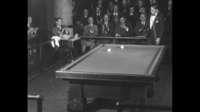 """swede wins u.s. billiard title. chicago, ill. - thurnblad defeats hall in close match for three-cushion championship"" / vs men playing billiards,... - ビリヤード点の映像素材/bロール"