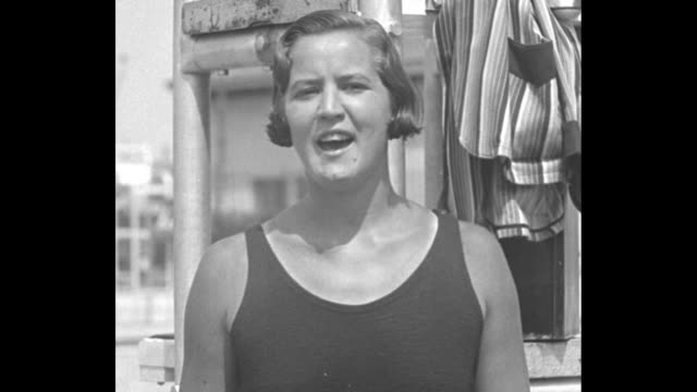 swimming star tells you how playland n y gertrude ederle show her strokes in sound film debut / ederle talks to camera then she puts on her swimming... - gertrude ederle stock videos & royalty-free footage