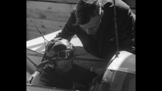 """""""teaches boys flying at home - aurora, ill. - aviation grows popular with younger set as unique wind tunnel gliding course opens"""" / man helps boy... - illinois stock videos & royalty-free footage"""