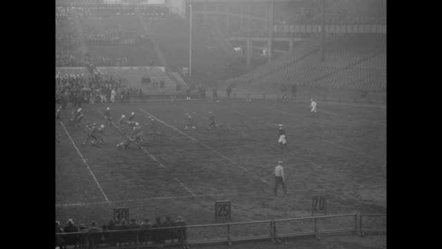 tennesee ends season with win over nyu eleven violets kick off to volunteers in stirring football fray / marching band on field at yankee stadium... - football goal post stock videos and b-roll footage
