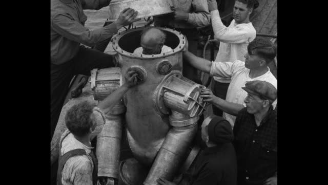 tests deepest sea diving suit saybrook point conn inventor bowdoin tries out 1400 pound robot made for treasure hunt/ the inventor harry bowdoin gets... - diving helmet stock videos and b-roll footage