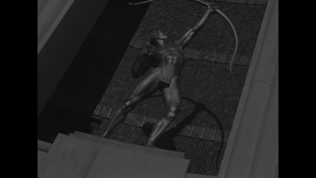 stockvideo's en b-roll-footage met superimposed over aerial shot of dallas / various shots of buildings and visitors at the pan american exposition / low angle shot of statue of archer... - 30 seconds or greater