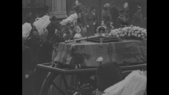 the british empire three kings in one year / overhead view of funeral procession of king george v in london / casket of george v on gun carriage... - palace stock videos & royalty-free footage
