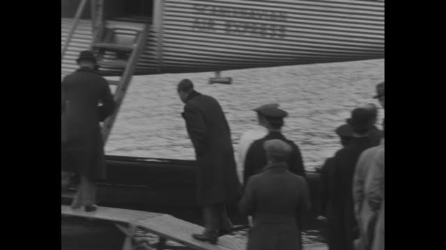 the british princes board their deluxe airliner for flight over stockholm / edward the prince of wales and prince george duke of kent walk on dock to... - prince stock videos and b-roll footage