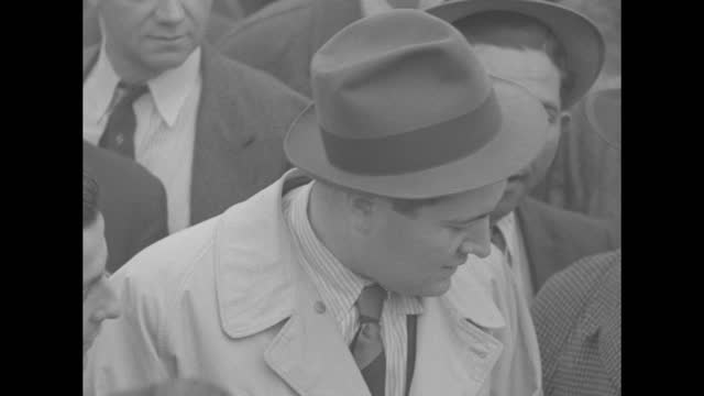 """stockvideo's en b-roll-footage met """"the camera reporter"""" superimposed over camera man turning camera around / story: vittorio mussolini, age 21, eldest son of benito mussolini, arrives... - signeren"""