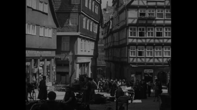 the city on the fulda cassel / vs cityscape kassel [city name spelling changed in 1928] / street scenes in downtown district with streetcar... - passing a note stock videos and b-roll footage
