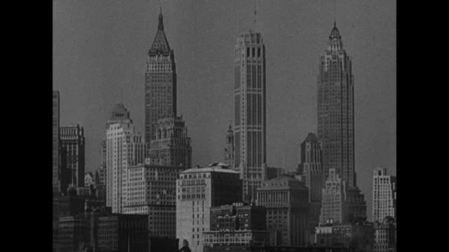 The Dewey Story / title card Presented by this theatre as a public service / buildings in Lower Manhattan skyline including 40 Wall Street American...