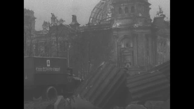 """""""the fall of berlin first pictures"""" / the brandenburg gate with russian sailors and soldiers at the end of world war ii / war debris, damaged and... - the reichstag stock videos & royalty-free footage"""
