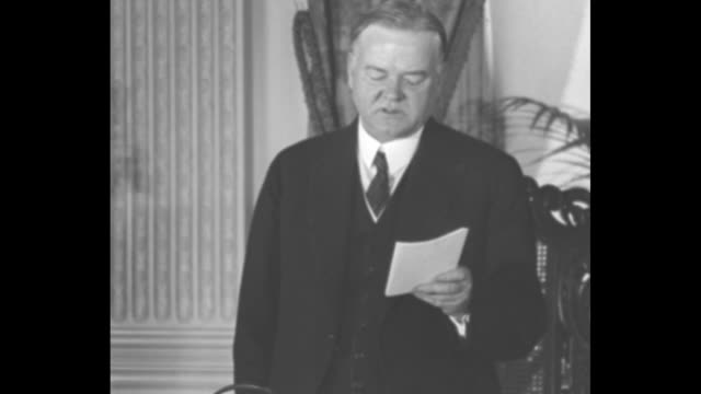 the formal declaration / president herbert hoover standing at table reading aloud microphones set up on floor / cu hoover reading kelloggbriand peace... - herbert hoover us president stock videos & royalty-free footage