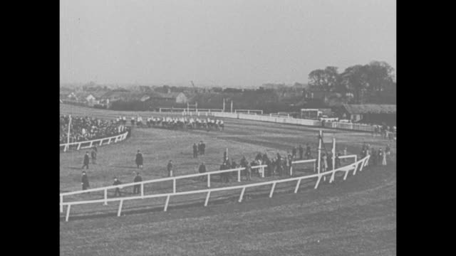 the grand national 1934 fade to exclusive and official pictures of the world's most exciting steeplechase at aintree england won by golden miller no... - fade in stock videos & royalty-free footage