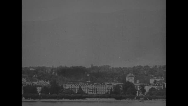 the league / headquarters of the league of nations palais wilson as seen from across lake geneva / pov from window of another building of palais /... - paramount building stock videos and b-roll footage