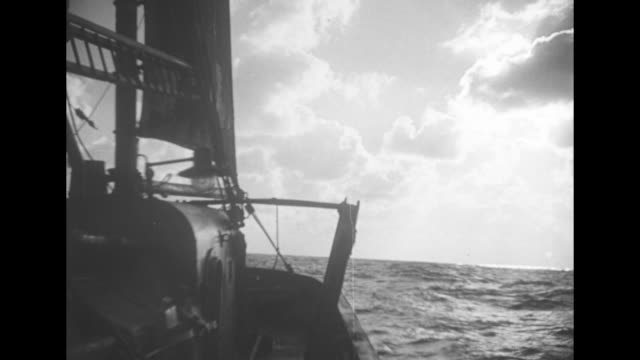 """""""the men who go down to the sea - the fishermen of britain, leaving lowestoft in their tiny craft"""" / vs harbor with numerous fishing boats and a from... - ローストフト点の映像素材/bロール"""