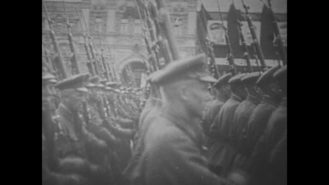 """the new watch on the rhine"" over black then superimposed over german soldiers marching / newspaper front pages with headlines ""germany reoccupies... - see other clips from this shoot 1900 video stock e b–roll"