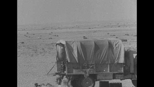 vídeos de stock, filmes e b-roll de the offensive phase / pan across widely scattered trucks in desert terrain / british field marshal bernard montgomery posing for photo opportunity... - líbia