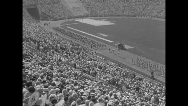 'The parade of nations Led by the athletes of Greece where Olympic originated000 march by in review '/ MS men sound trumpets from top of stadium / VS...