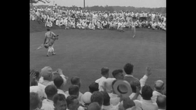 the shot that wins bobby's sensational 40foot putt on last hole clinches championship smashing course record / long shot as crowd surrounds bobby... - pga event stock videos and b-roll footage