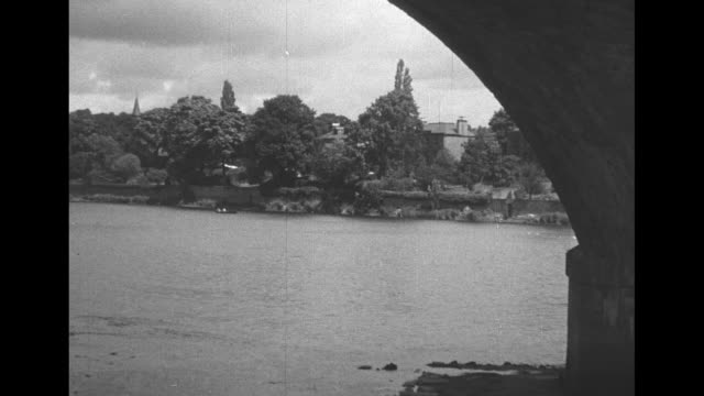 the town on the tay perth / three shots of st john's bridge over river tay and city in background / people walking in north inch park along river /... - paramount building stock videos and b-roll footage