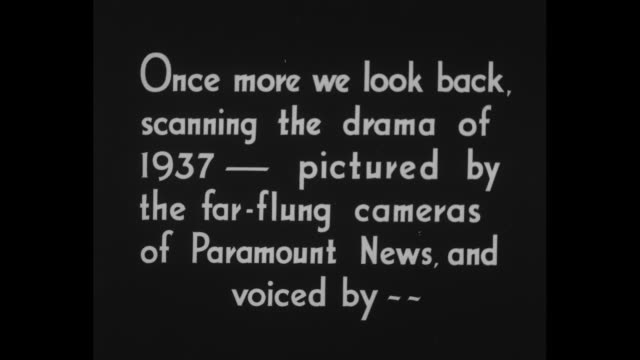 """stockvideo's en b-roll-footage met """"the world in 1937"""" / title card: """"once more we look back, scanning the drama of 1937 - pictured by the far-flung cameras of paramount news, and... - city of neighbors: give once for all film title"""