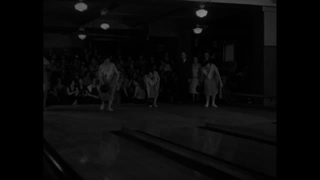 these ladies know how to roll 'em women's bowling championships produce real experts in the art of upsetting nine pins in new york / front view of... - bowling ball stock videos & royalty-free footage