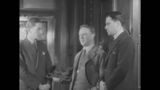 """""""this theatre gets plaque for perfect sound! e. o. heyl of rca-victor photophone makes presentation to manager wood"""" / heyl holding plaque standing... - rca stock videos & royalty-free footage"""