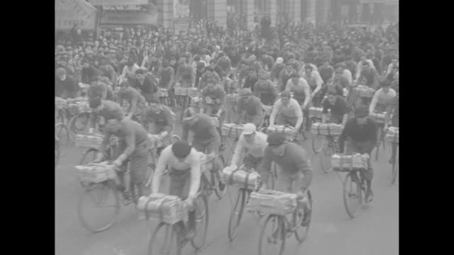 three wheeling paris tricycle delivery boys in grueling grind crash marks finish of 25mile race through streets of french capital / shot of eiffel... - 1932 stock videos & royalty-free footage