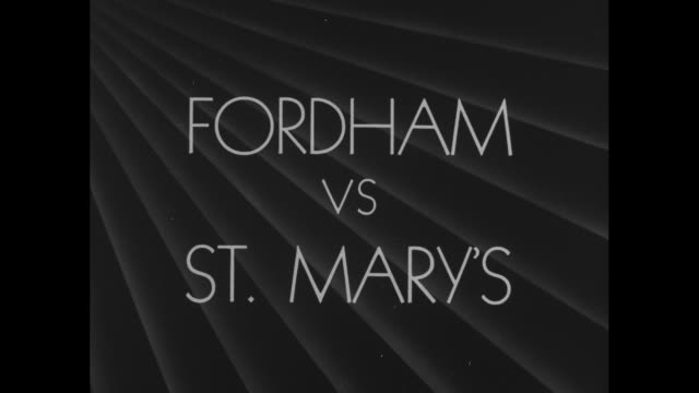 title card thrills in the area of football fordham vs st mary's / in game at the polo grounds st mary's gaels kick off to fordham rams fordham's john... - joe pass stock videos and b-roll footage