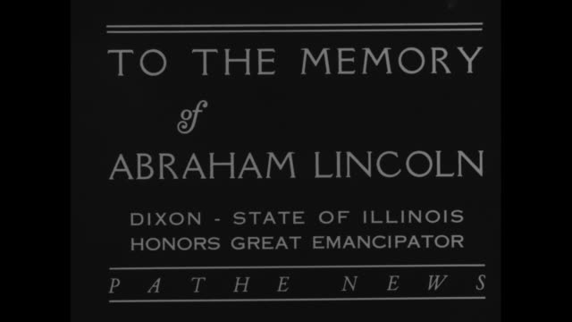 """""""to the memory of abraham lincoln-dixon-state of illinois honors great emancipator"""" / men pull veil away from lincoln statue, officials on reviewing... - witness stock videos & royalty-free footage"""