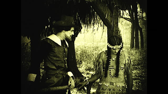 """""""to the shed where john rolfe dried his tobacco pocahontas often came, telling him how her own people gew 'the weed that smokes'""""; native american... - 17th century stock videos & royalty-free footage"""