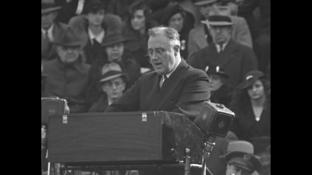 ''Today We Are Solvent' Roosevelt' / VS crowds in stands on football field around goalposts at Grant Field in Atlanta as they attend a speech by US...