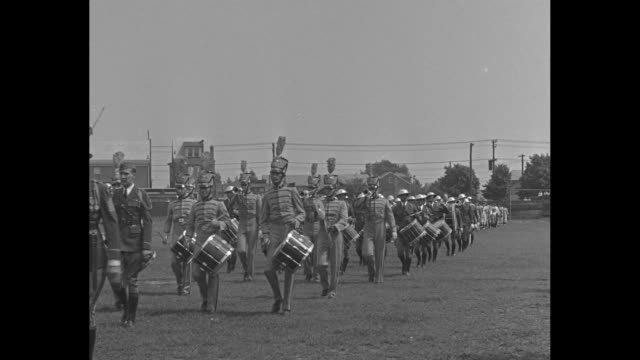 Trenton Post Wins Junior Legion Game / militarystyle band marches onto playing field followed by officials / shot of allmale crowd in stands on feet...