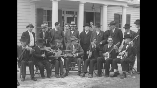 tune up for fd presidentelect roosevelt serenaded by old fiddlers at warm springs ga / men look on as the seated solemn franklin roosevelt surrounded... - banjo stock videos & royalty-free footage