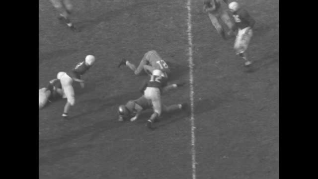 Title card UCLA vs Stanford / VS football game Dick Horn of Stanford throws long pass Joe Sabol of UCLA intercepts ball then makes 28 yard run with...