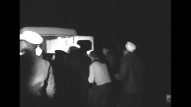 vidéos et rushes de us news / title trapped on bottom navy diver safe after 8 hours superimposed over rescue boat on river / night vs sailors lift rescued diver joseph... - actualités cinématographiques