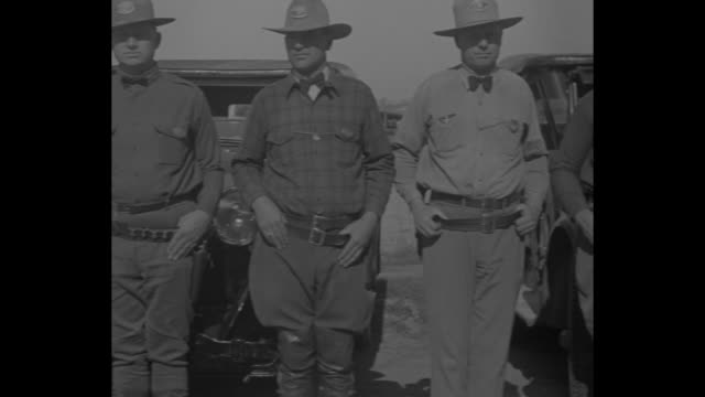 us wages a smuggler war san diego cal chief inspector swaybee tells of labors on mexican boundary / close shot of swaybee standing outdoors talking... - 1920 1929 stock videos & royalty-free footage