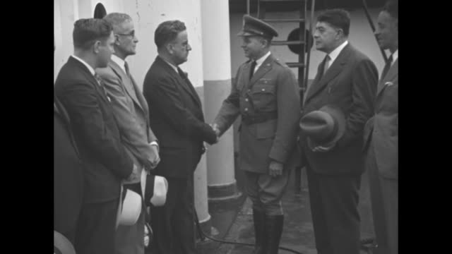 """welcomes envoy alfaro of ecuador - maj. sandeford greets new minister who once attended west point"""" / maj. a. c. sandeford, standing on left of... - west point new york stock videos & royalty-free footage"""