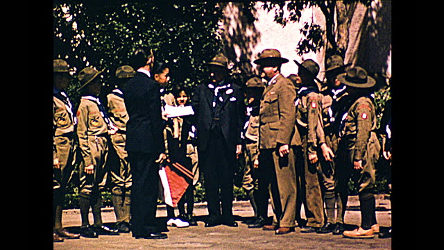 """vallejo's boy scout troop 8 at treasure island 1939""; two men in suits greeting boy scouts running off a blue bus with sign ""special""; boy scouts... - 1930 1939点の映像素材/bロール"
