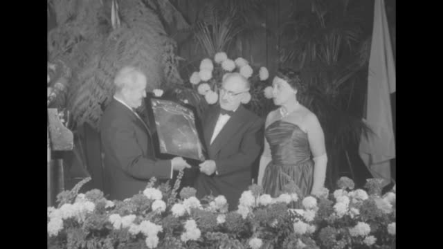 variety clubs honor jane froman dr waksman superimposed over ws of banquet ceremony / cus jack beresin of the variety club presents humanitarian... - plakette stock-videos und b-roll-filmmaterial