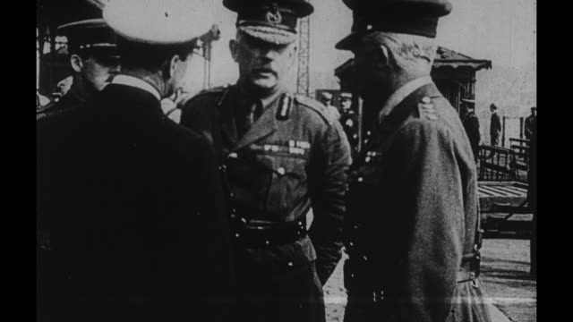 viscount french commander of britain's home force and maj gen sir francis lloyd / the men talking among themselves as they await the arrival of gen... - john pershing stock videos & royalty-free footage