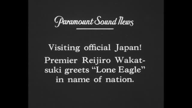 visiting official japan premier reijiro wakatsuki greets 'lone eagle' in name of nation / charles lindbergh reijiro wakatsuki and william cameron... - charles lindbergh stock videos & royalty-free footage