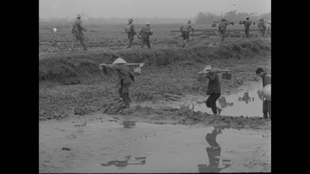 """""""war in indo-china"""" superimposed over front view of french troops advancing along road, trees on both side of the road / armored tank carrying... - winding road stock videos & royalty-free footage"""