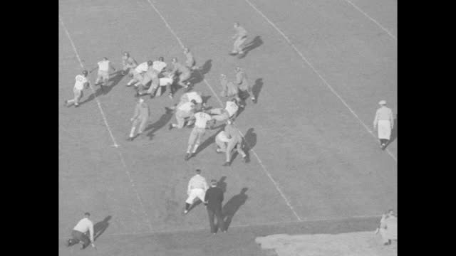 """washington beats bears"" / title card: ""california kicks off"" / title card: ""washington kicks off"" / title card: ""the winning touchdown"" / various... - university of california stock videos & royalty-free footage"